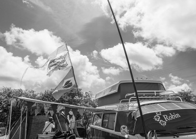Camper van with flags in the camping field at Priddy Folk Festival