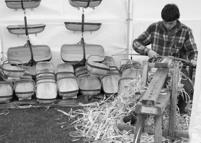 A man making baskets in a craft tent at the Malvern show
