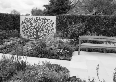 A Malvern show garden with curly tree decoration