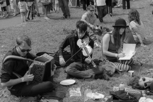 Young musicians practice on the green at Priddy Folk Festival