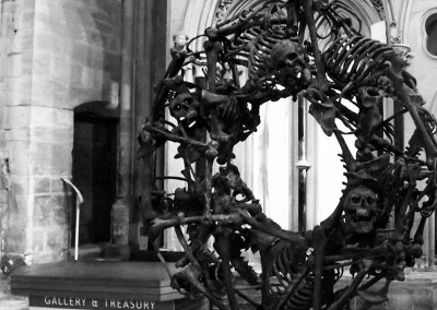 Skulls and bones sculpture at Gloucester Cathedral