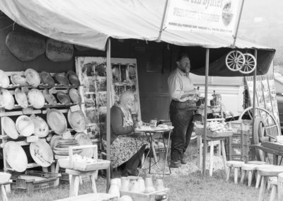 A couple working at a woodwork stall at the Malvern Show 2016