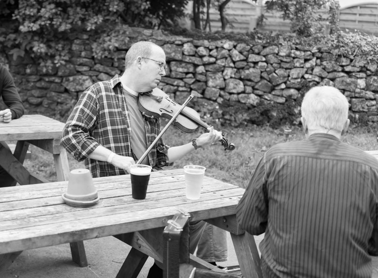A pub session starts outside the pub in Priddy durring the festival