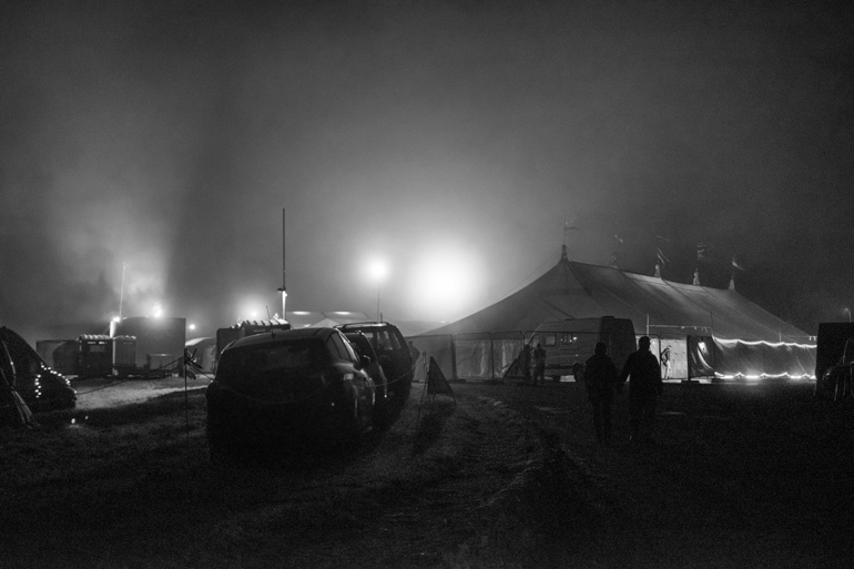 Outside Swildons marqee at Priddy Folk festival seen during a misty night