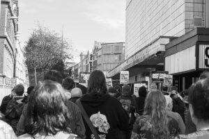 Anti-austerity march approaches Broadmead shopping centre in Bristol