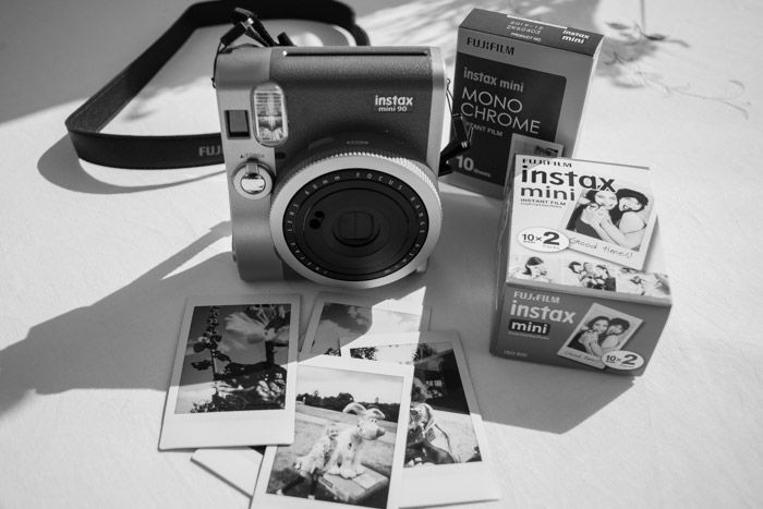 Instax Mini 90 camera with film packs plus example photographs