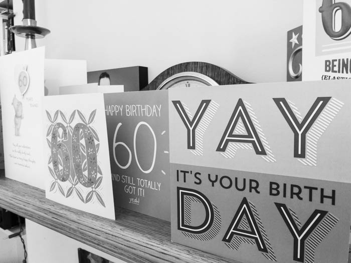 Sixtieth birthday cards on a shelf